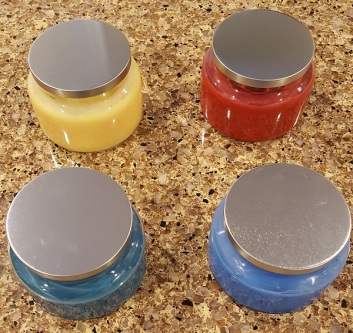 4 hand-poured, scented, soy candles all etched with different designs