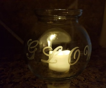 """GLOW"" candle holder"