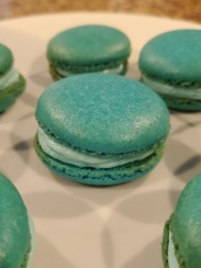 Berry blue macarons sandwiched on platter